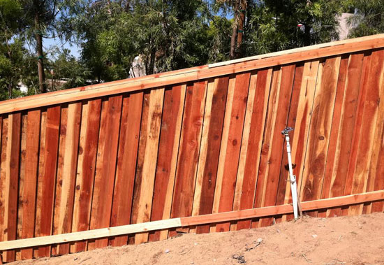we installed this wood fence in lake elsinore ca this residential fence features a cap and trim board and board wood fence